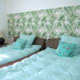Betten in grün und türkis